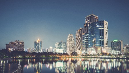 benjakitti: Bangkok city downtown at night with reflection of skyline, Bangkok,Thailand (Vintage filter effect used)