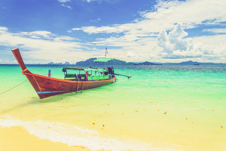 long tailed boat: Long tailed boat at Kradan island, Thailand (Vintage filter effect used) Stock Photo