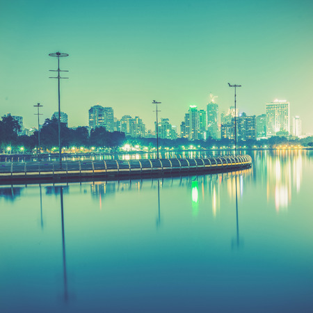 City at night with reflection of skyline,Vintage tone Stock Photo
