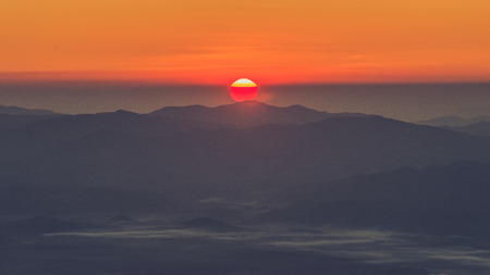 faintly visible: Sunrise view point , doi angkhang , chiangmai , thailand (Vintage filter effect used) Stock Photo