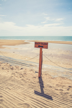 beach access: Beach access sign (Vintage filter effect used)