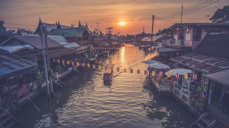 Floating market Amphawa evening at Samut Songkhram  (Vintage filter effect used)
