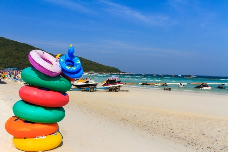 rubber ring: Colored ring on the beach at coral island or Koh Larn ,Pattaya  Stock Photo