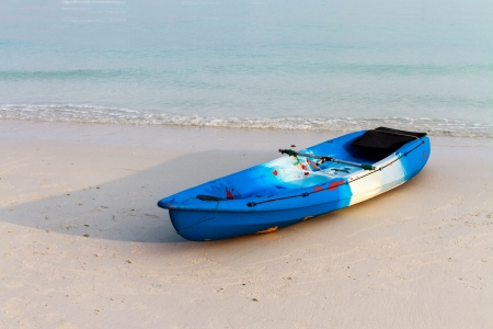 Blue kayak on a tropical beach, Koh Samui, Thailand photo