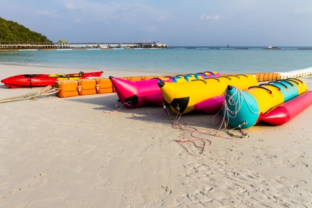 banana boat lays on a beach photo