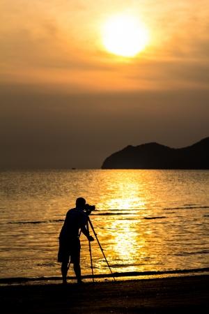 silhouette of Photographer Stock Photo
