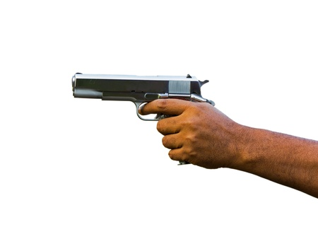 Gun in hand over white background