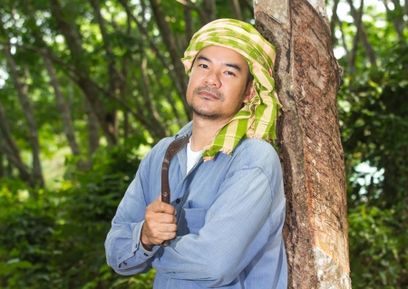 Asian man rubber tapper photo