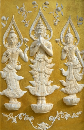 Lanna Buddhist sculptures juxtaposing of northern Thailand.