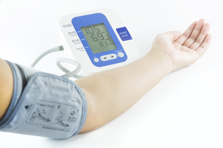 Show how to measure blood pressure with electronic blood pressure meter photo
