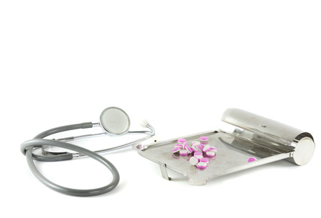 Stethoscop and  Medication tray medical equipment isolated on white photo