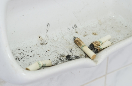 ciggy: many cigarette butts close up in ash receiver
