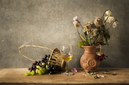 composition art: Still life Photography with wine, grape and flower on wooden table and dark grunge background