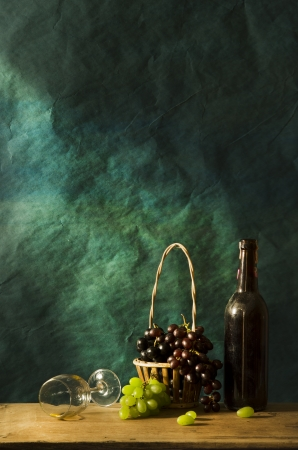 Still life Photography with Old red wine on wooden table and blue grunge background Stok Fotoğraf