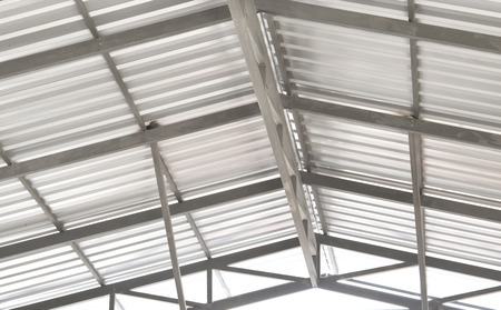 corrugated steel: Architectural detail of metal roofing on commercial construction of modern building complex Stock Photo