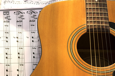 masters of rock: Guitar and musical notes on paper Stock Photo