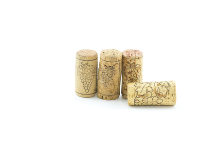 dated: Dated wine bottle corks on the white background. Close up