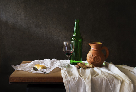 Still life Photography with  red wine on wooden table and bread photo