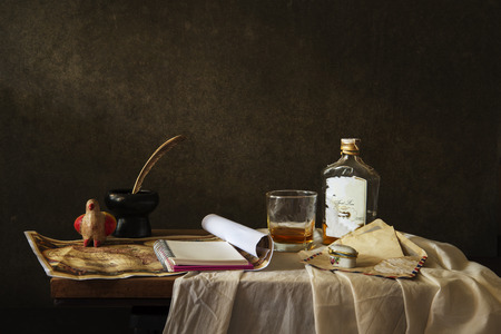 Still life Photography with  map and note ,whisky on wooden table
