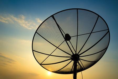 data transmission: satellite dish on sunset blue sky, skies Stock Photo
