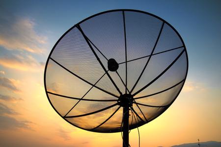 parabolic: satellite dish on sunset blue sky, skies Stock Photo