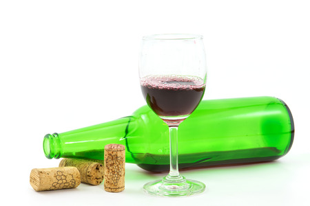 vintage wine corks,red wine in wineglass on white background. Stock Photo