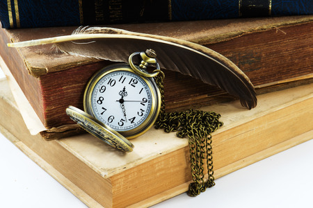 pocket book: Vintage grunge still life with antique pocket watch, and old book  ,quill