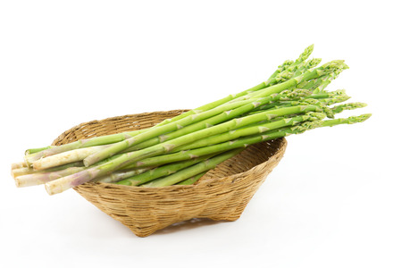nutritiously: asparagus in basket  isolated on a white background