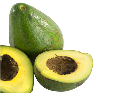 exotics: Two Avocado and half  isolated on a white