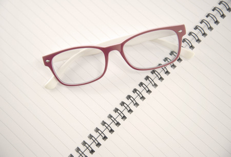 Vintage Eye glasses on notebook photo