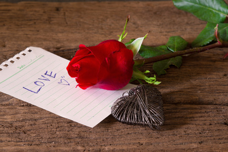 Red roses on wood and paper of love,heart photo