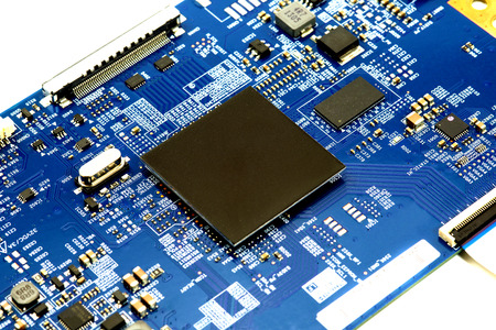 microprocessors: close-up of electronic circuit board with processor background Stock Photo