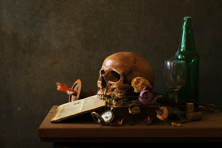 still life art photography on human skull skeleton with desk Stock Photo