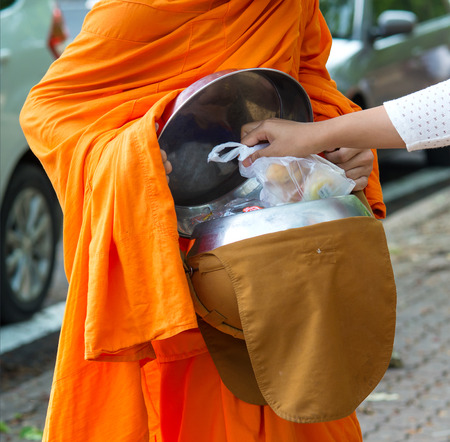 alms: Buddhists have faith in Buddhism. giving alms to monks  receive alms