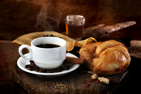 breakfast hot coffee  with honey and croissant photo