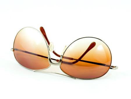fashion men sepia sun glasses isolate on white photo