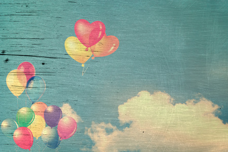 spaciousness: vintage heart  colorful balloon on blue sky concept of love in summer and valentine