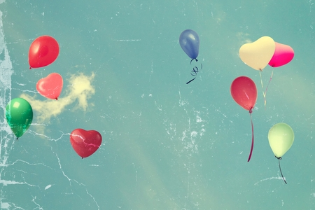 spaciousness: vintage tattered photo paper heart balloon on blue sky concept of love in summer and valentine