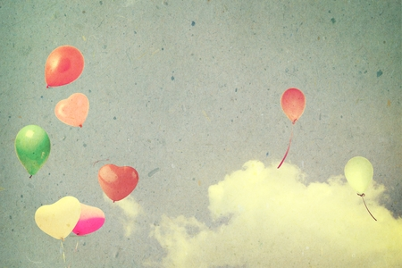 spaciousness: vintage  heart with colorful balloon on blue sky  in summer