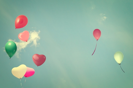 vintage heart balloon on blue sky concept of love in summer and valentine photo