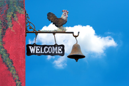 door bell: Classic Door Bell with silhouette  of  chicken, vintage welcome label  on blue sky with cloud