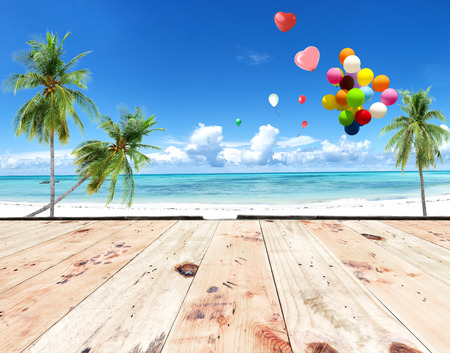 spaciousness: wooden floor with heart balloon on beach blue sky concept of love in summer and wedding honeymoon