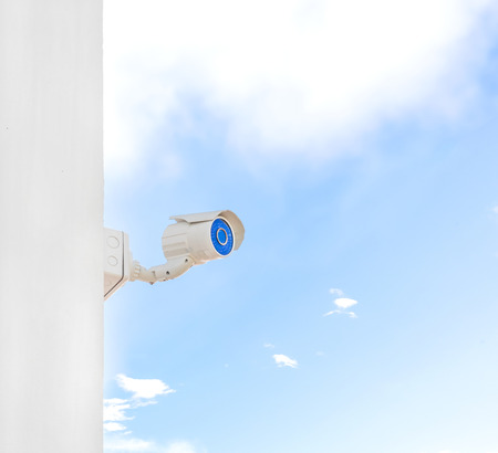 close circuit camera: CCTV or surveillance camera on blue sky with clouds background