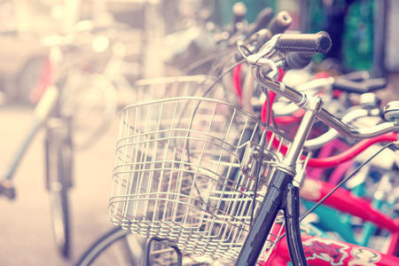 parking space: Detail of a Vintage Bicycle Travel Resting in the city Street  Stock Photo