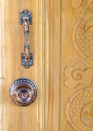 closed door: doorknob vintage design on wooden door Stock Photo