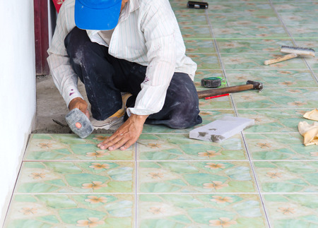 floor tiles: Man building contractor Floor tile installation, for  Home Building