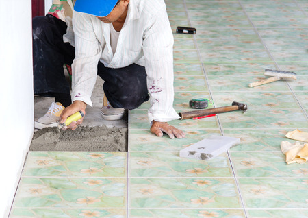 Man Building Contractor Floor Tile Installation For Home Building