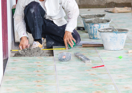 Man building contractor Floor tile installation, for  Home Building photo