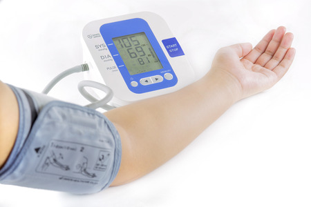 Show how to measure blood pressure with electronic blood pressure meter on arm and hand of female