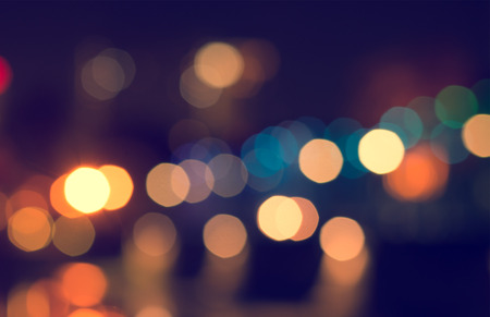 bokeh: Lights blurred bokeh from christmas night party for your design, vintage or retro color tone Stock Photo
